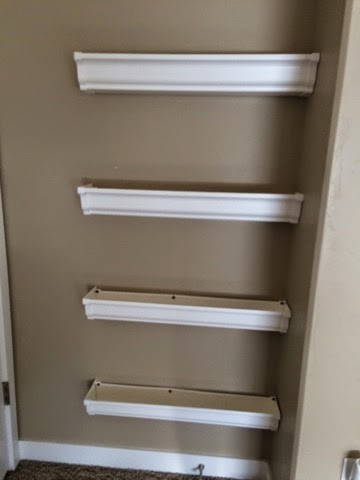 Diy bookshelves nightchayde for Plastic rain gutter bookshelf