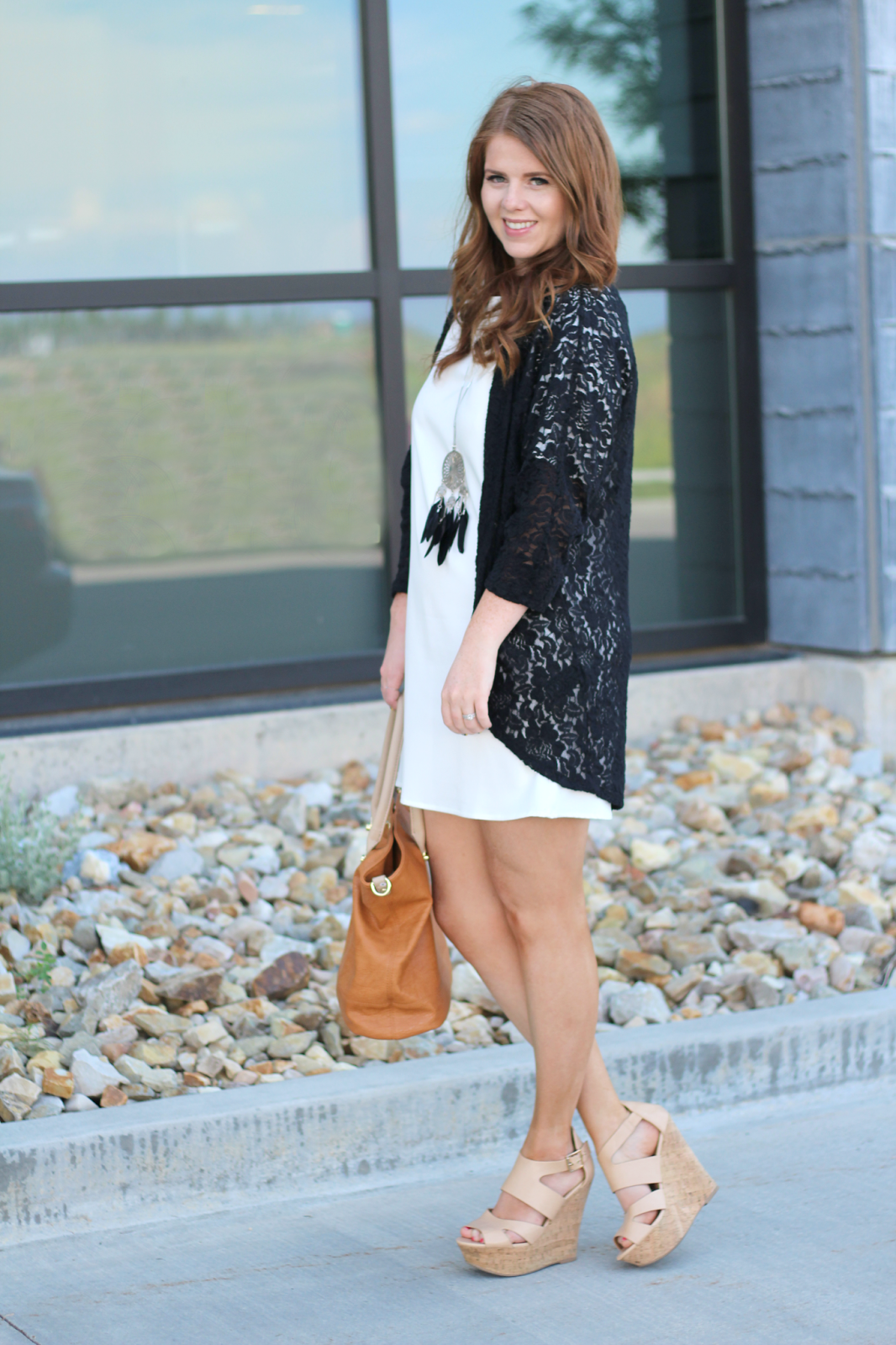 White Dress with a touch of black lace. graphic