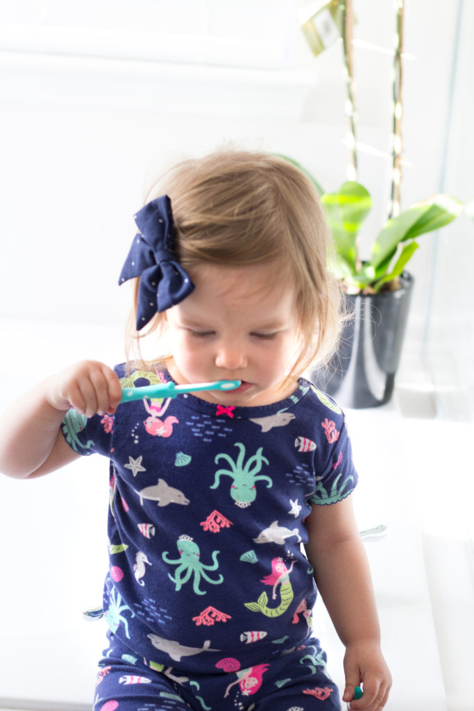 Way to get your toddler to brush their teeth (tips, tricks and products to help)